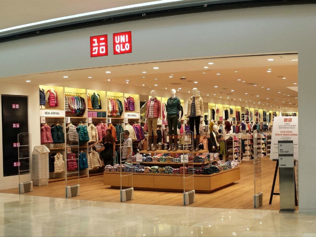 Uniqlo store in Sydney, Australia with 3 people shopping around