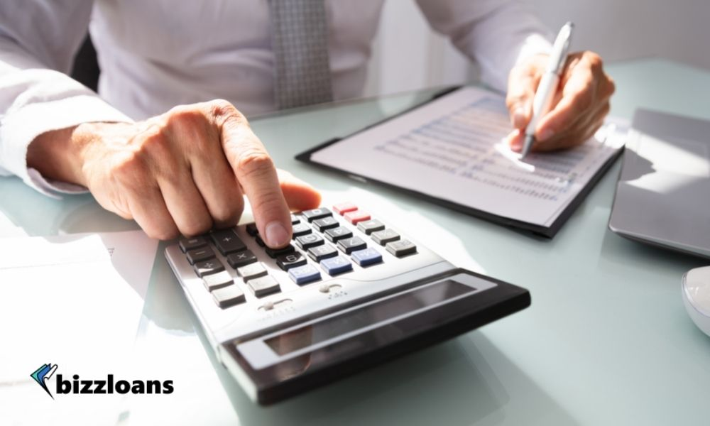Business owner calculating invoice