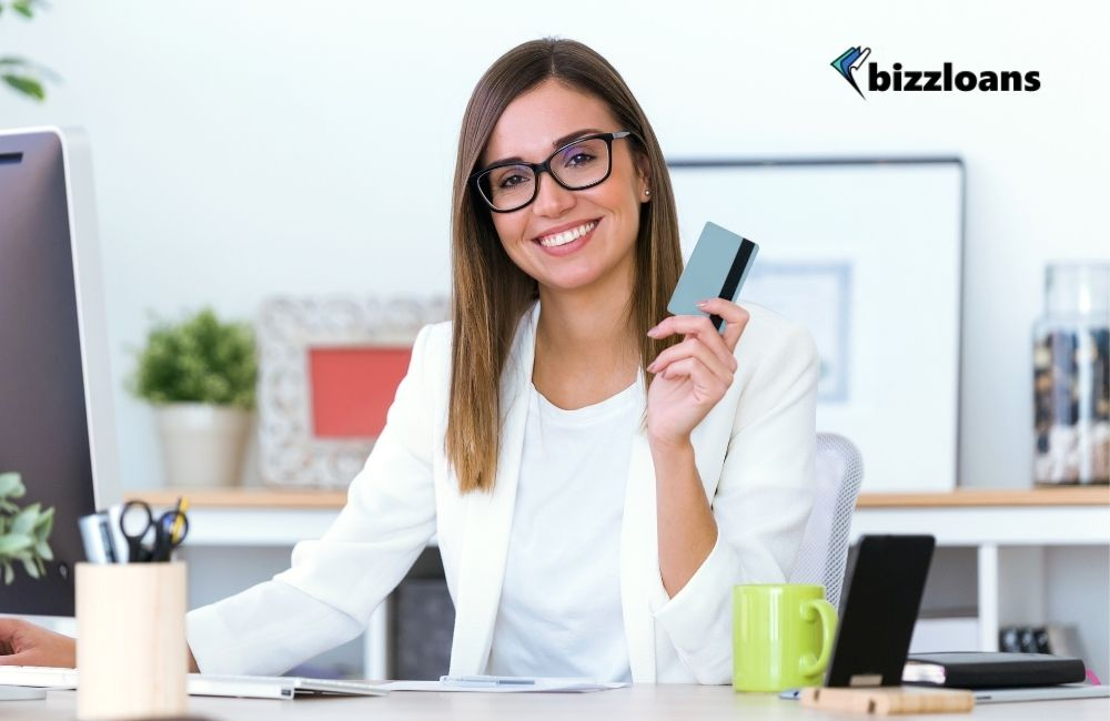 Young business owner using a credit card for her business needs