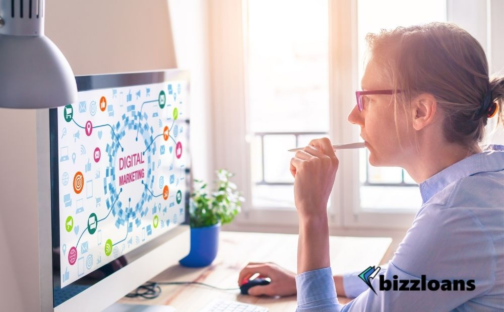 Woman using computer with digital marketing concept on the screen