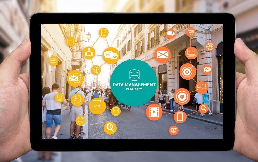 hands holding a tablet with Data Management Platform concept