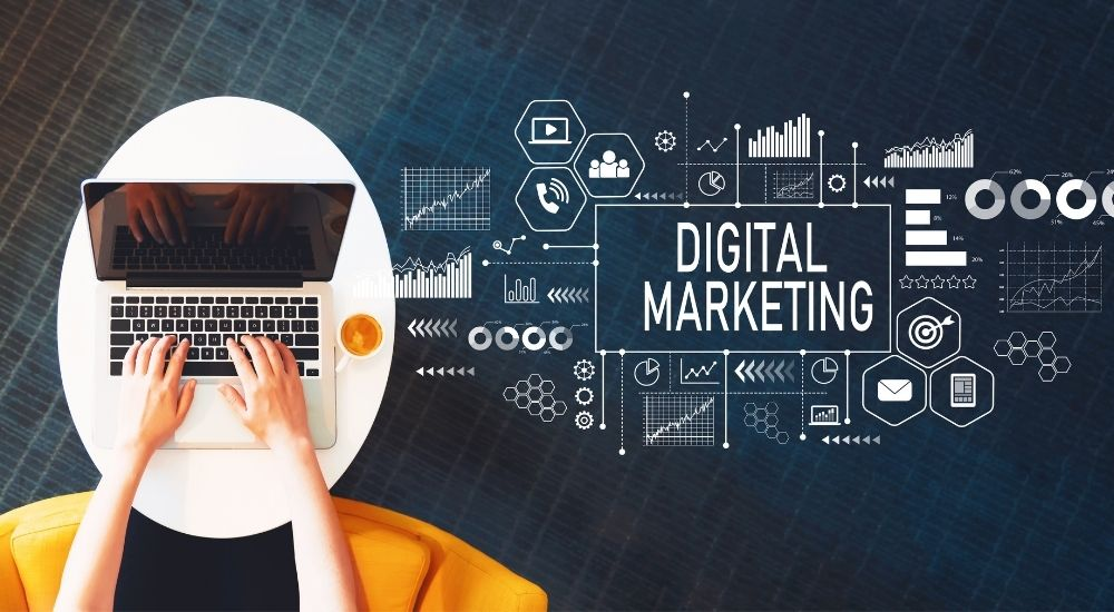 hands of a business owner using a laptop with digital marketing concept