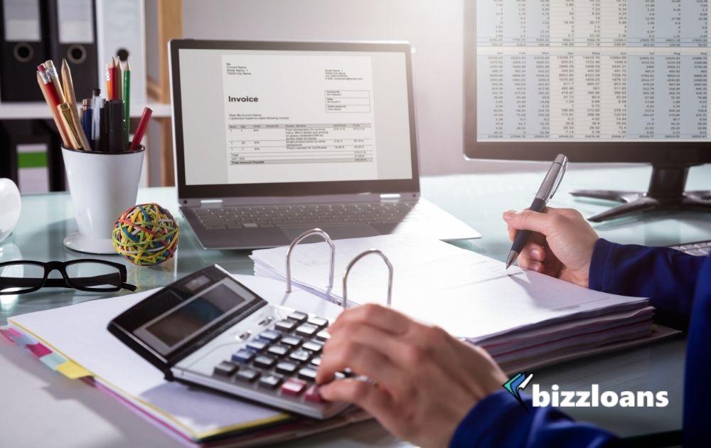 businessperson calculating invoice