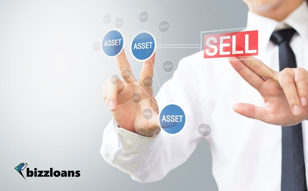 hand of a businessman selecting which assets to sell