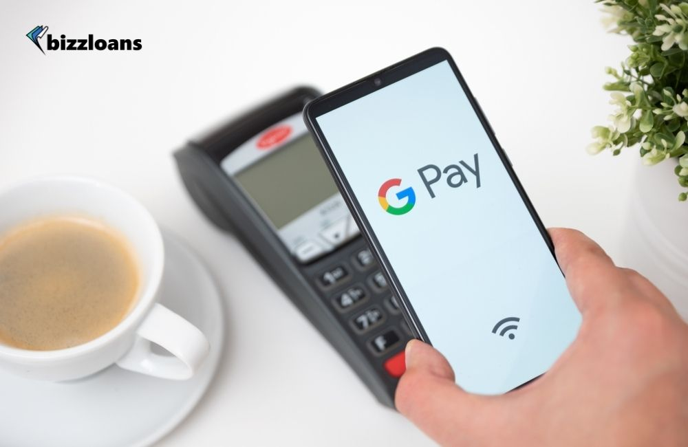 Man holding smartphone with Google Pay logo which is one of the best mobile payment app