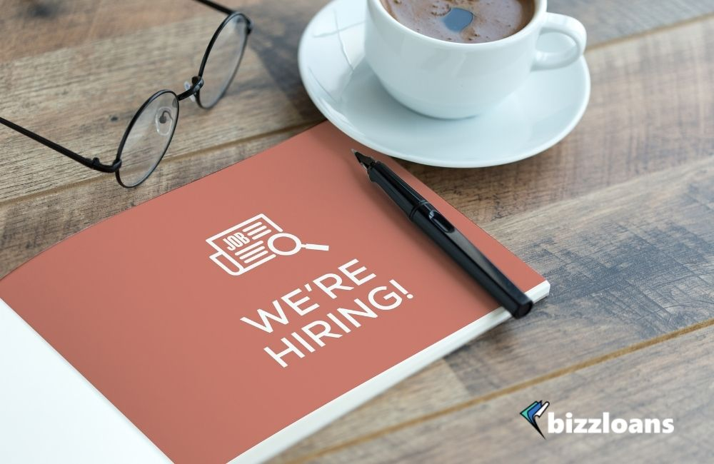 We're Hiring Concept - written on a booklet