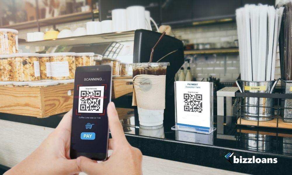 Man scanning Qr code payment in cashier, E wallet, cashless technology concept.