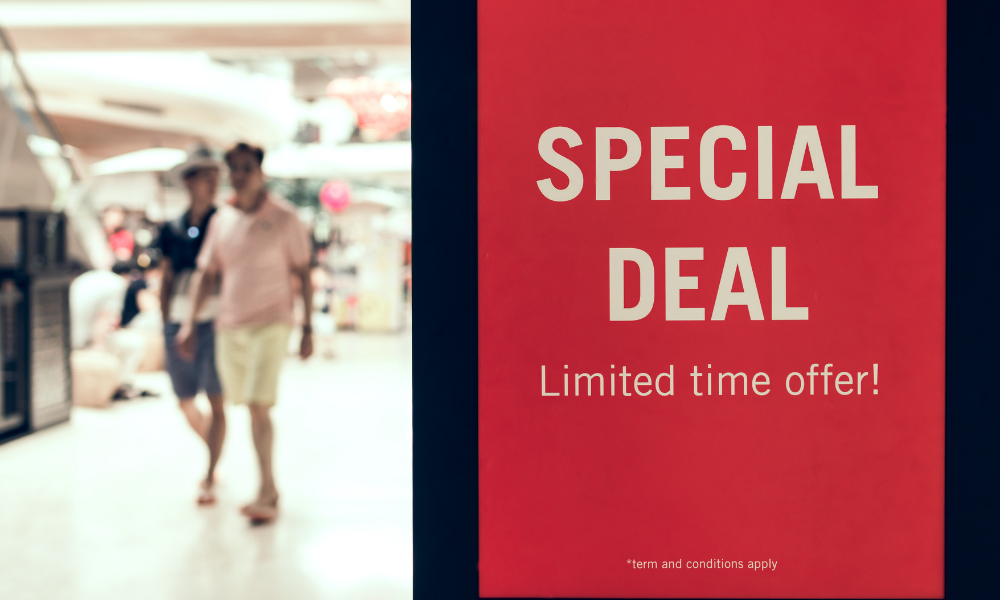 Special Deal poster in the shopping mall and two men walking