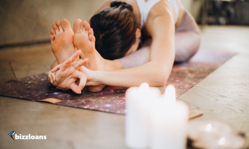 business owner doing yoga as one of the mental health tips